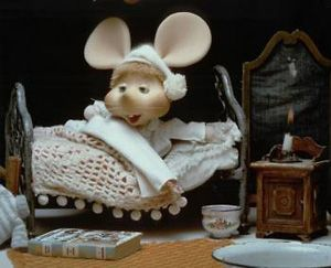 "Topo Gigio on the Ed Sullivan Show.  I used to go to bed right after this.  He said ""Kiss me good-night"".  Look how adorable his little bedroom is with the crocheted bedspread and the tiny candle."