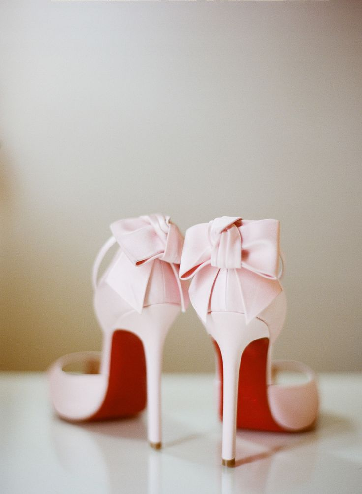 Light pink stiletto Christian Louboutins. Love the pretty pink bows!