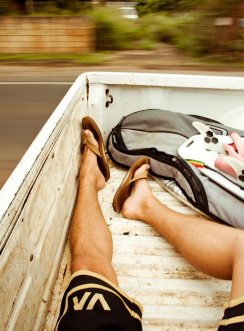 Hitching a ride to the beach in the back of a truck.