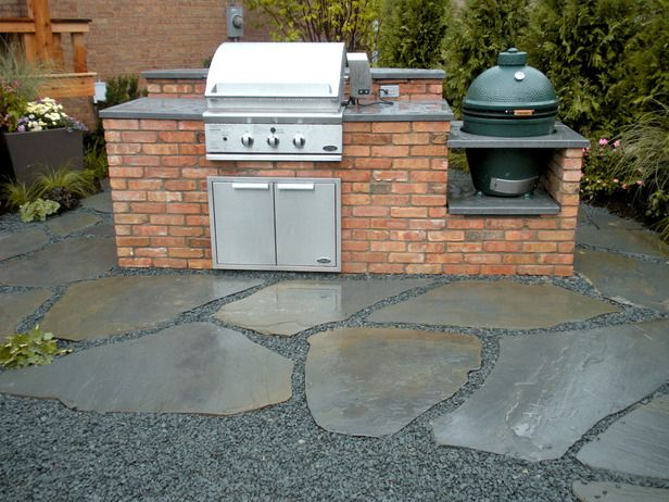 How to Build a Double Grill Island - This island functions as both a grill station and a seating area, with a built-in grill and smoker and a raised, curved bar top at the back.