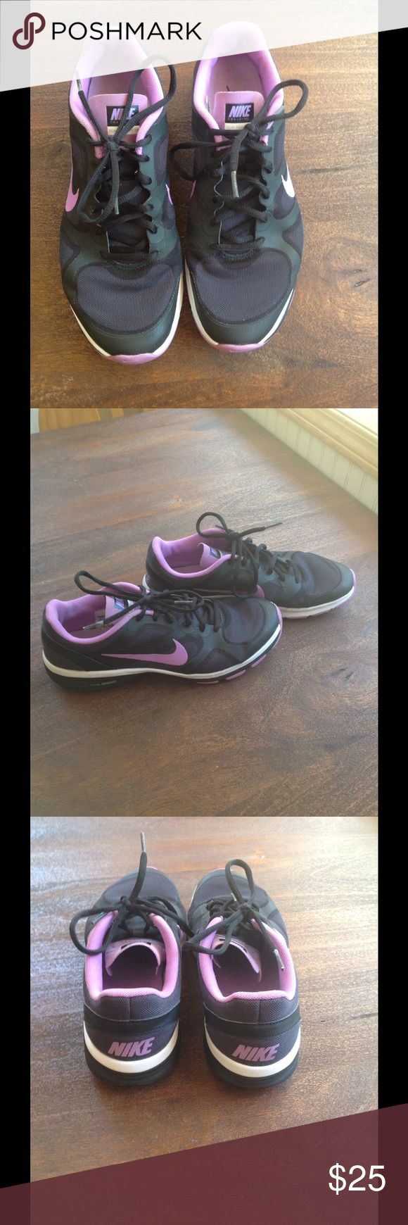 Nike Dual Fusion Running Shoes Great used condition. Slight wear but still in awesome shape. Dual fusion. Black and purple. Women's 9.5. Nike Shoes Sneakers