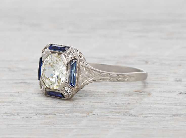 this is it. My dream engagement ring! The cut on the jewel is beautiful. The bezel and setting are incredible! The filigree design around the band is just gorgeous. And the sapphire around the edges give it such a beautiful and elegant touch. My vintage ring dreams come true