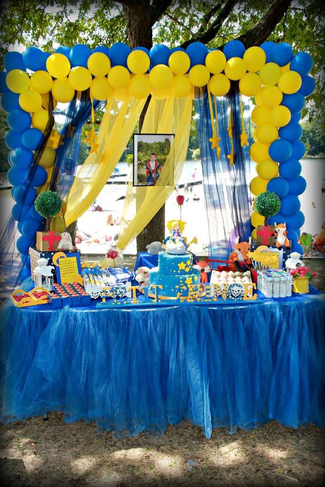 An incredible backdrop and dessert table at a Little Prince boy birthday party! See more party planning ideas at CatchMyParty.com!