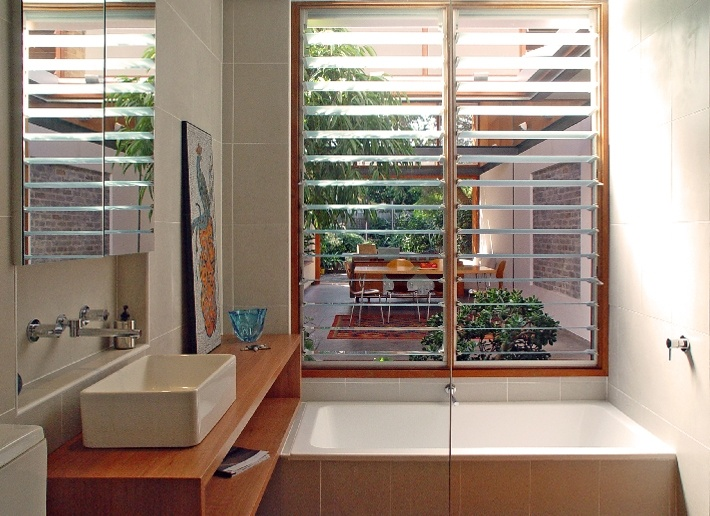 CplusC - Sydney Architects and Builders. Newtown Terrace House Bathroom. Opening to private courtyard, providing ventilation, light and outlook. #sydney #architect #bathrooms #green design