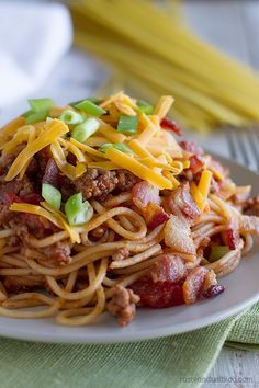 Cowboy Spaghetti - A change up from traditional Italian spaghetti and meat sauce, this Cowboy Spaghetti adds in bacon and cheddar cheese for an American twist on a classic.
