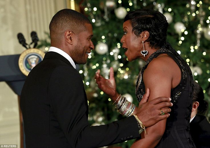 R&B star Usher says an excited hello to George Lucas' wife, Mellody Hobson, at the gala ev...