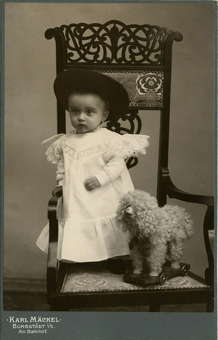 Aside from how adorable this baby is in her sweet victorian dress, I love the intricate detail of the chair.