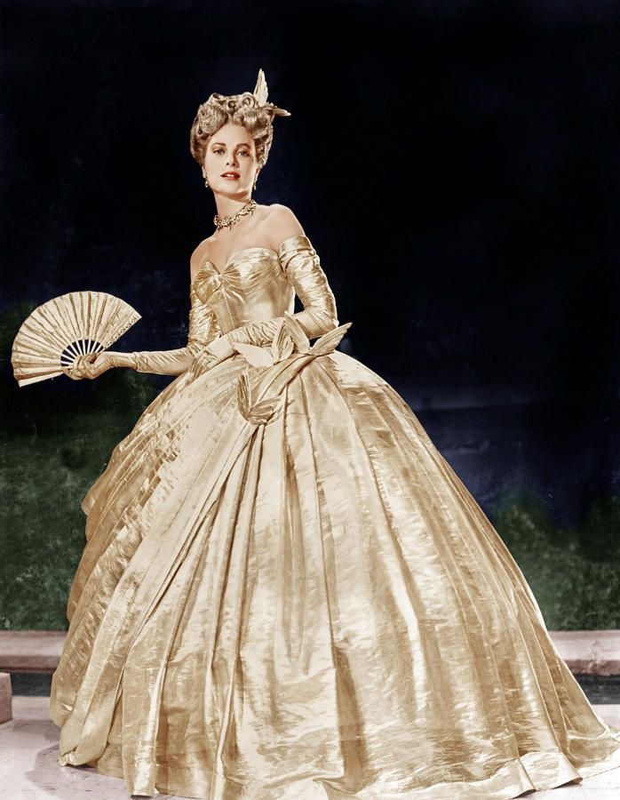 "Need some vintage inspiration? Grace Kelly wearing Edith Head's gold masquerade ball gown in ""To Catch A Thief,"" 1954:"