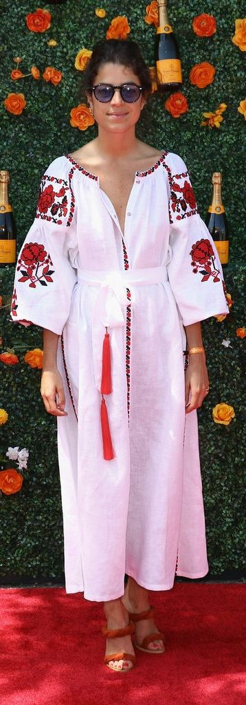 We can't help but swoon over Leandra Medine's white and red embroidered dress. It's a throw-on-and-go look that packs a powerful punch.