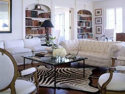 zebra print rug and white tuffed couch