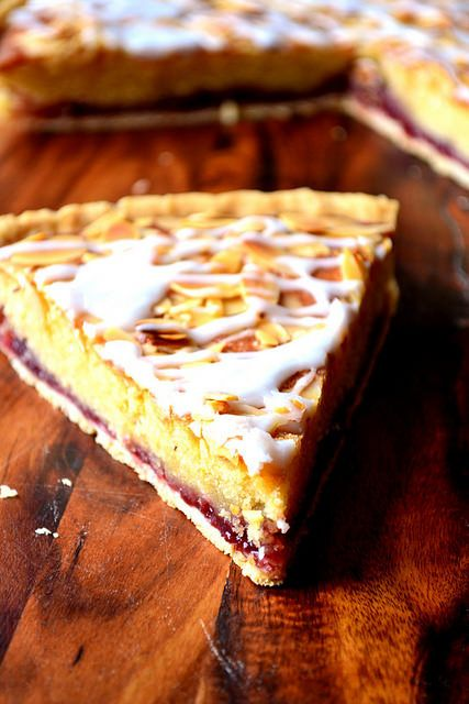 Cherry Bakewell Tart - a classic British tart with a storied history, flavoured with delicious cherry jam and a delicate almond-infused frangipane sponge.
