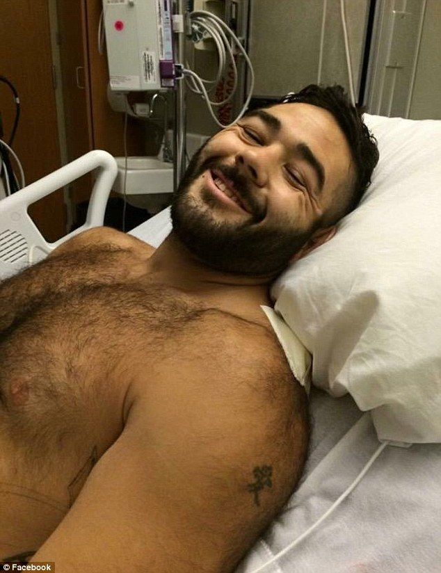 Army veteran Chris Mintz (pictured in the hospital, recovering) was shot seven times as he charged at the Oregon college shooter, his cousin told DailyMail.com