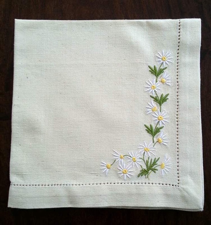 Daisies embroidered on natural linen napkins with drawn thread hem. NellyBelle Designs