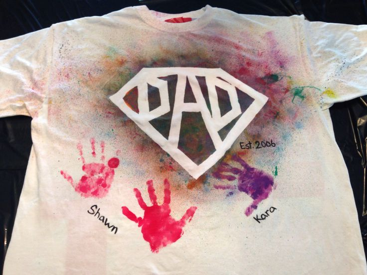 Super Dad DIY Father's Day T-Shirt. All you need is some tape to block out the shape then just spray with fabric paint in various colors, add the kids handprints and you have nice homemade shirt for Dad.