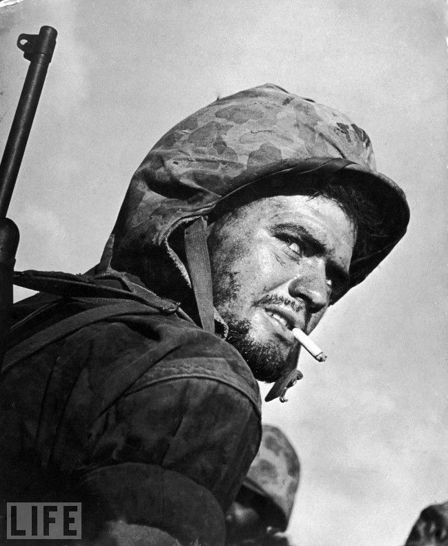 This has been one of my fav photos since I discovered it at 13 <3 MARIANAS ISLANDS - JULY 15: Grizzled & weary US soldier smoking a cigarette during the final days of fighting to gain control of the island of Saipan from occupying Japanese forces during WWII.