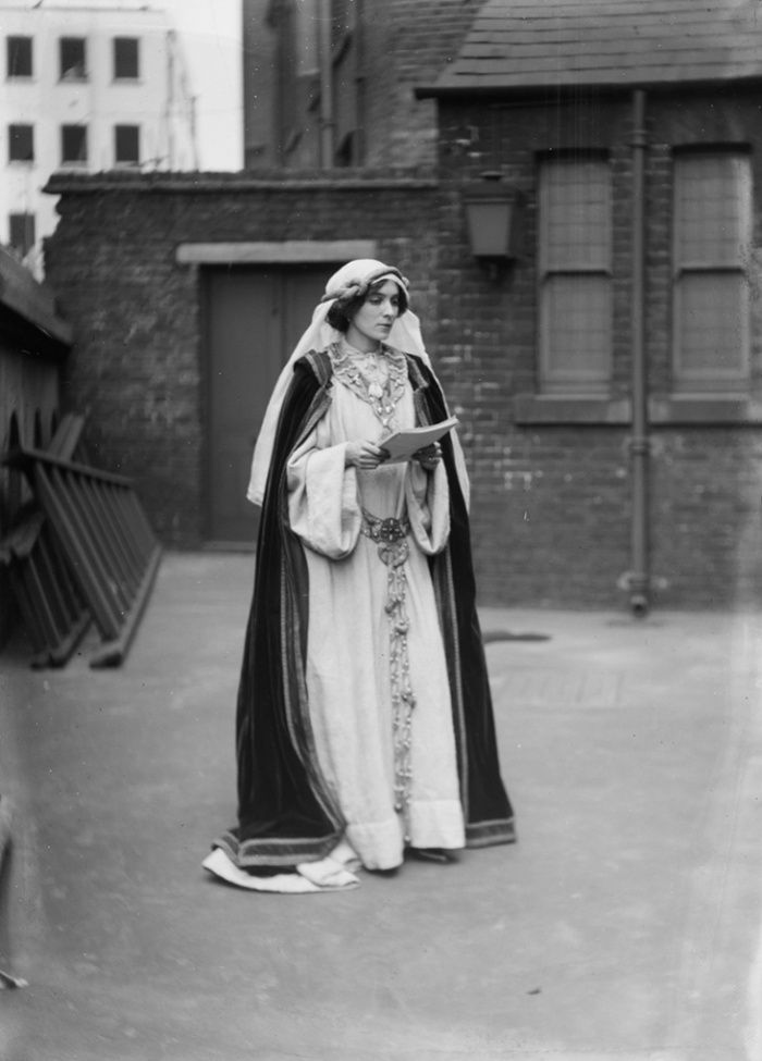 Soldiers in petticoats: A suffragette in costume at the Green, White and Gold fair, organised by the Women's Freedom League, 1909