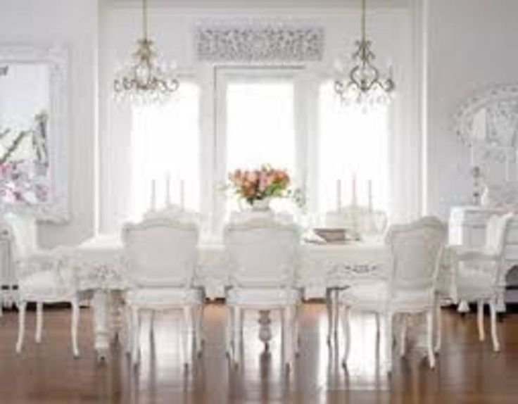 White Scalloped Chairs Around Dining Room Table With TWO Chandeliers Overhead FROM Gorgeous Light Bright Traditional Style Crystal