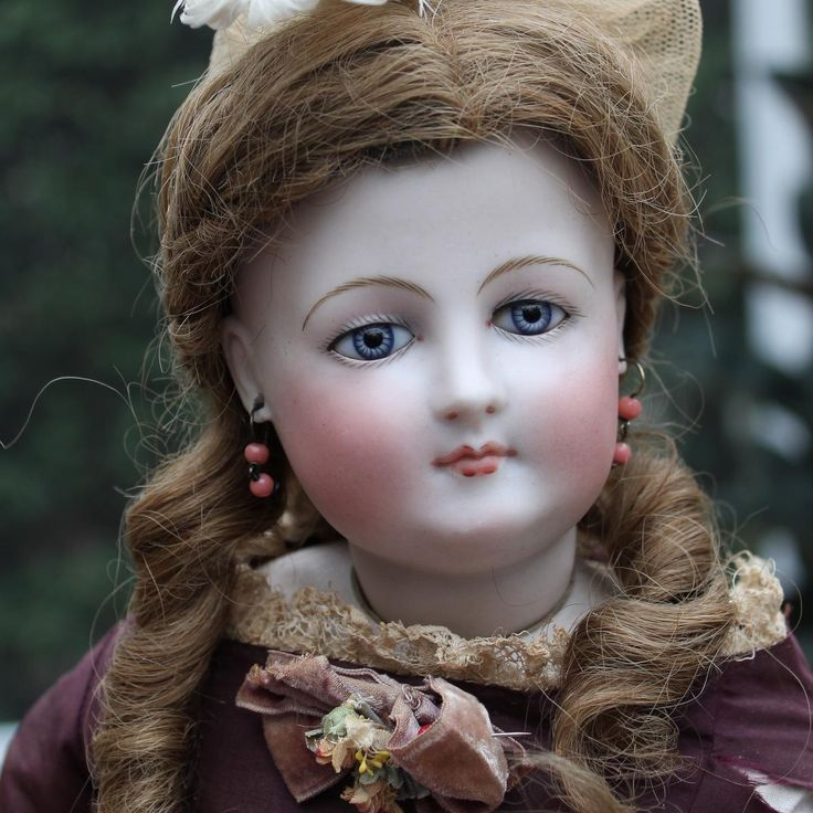 Offered is a stunning 19 early French Fashion doll most likely made by the firm of Jumeau with a terrific face and wonderful antique clothing. Her
