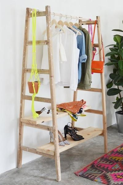 """DIY ladder clothing rack Perfect for clothes that are """"in use"""" during the week, and most frequently used shoes. I'd had some pegs/hooks/door knobs on the sides for stuff that doesn't need a hanger.:"""