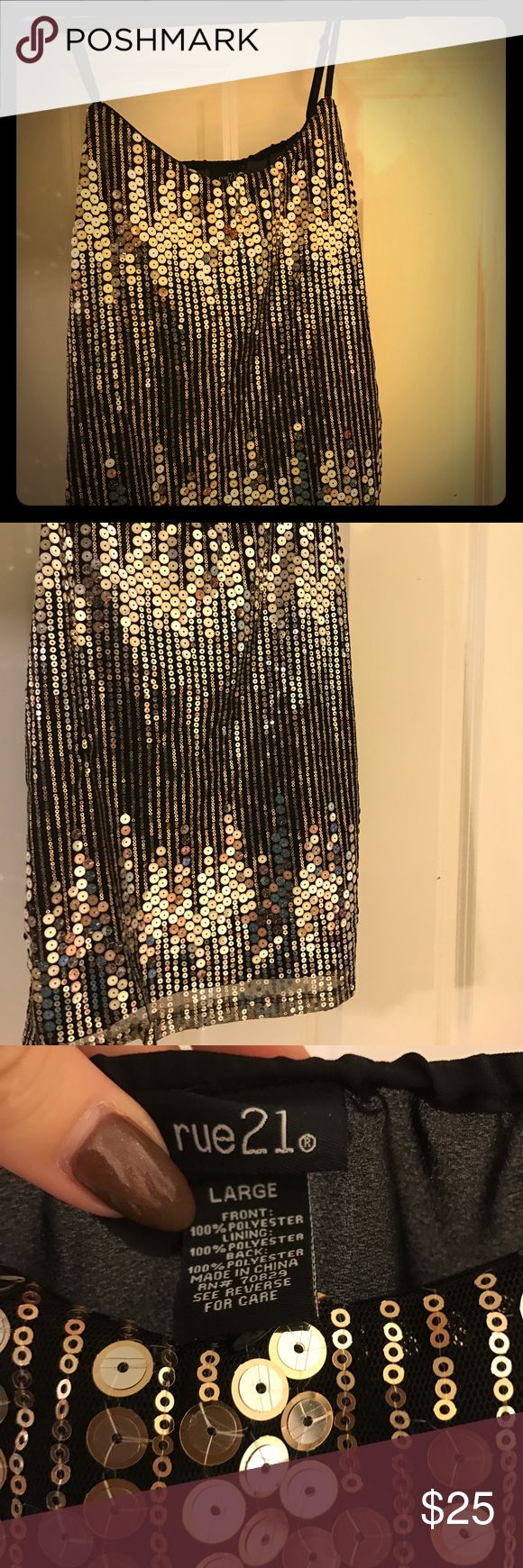 Gorgeous Gold Sequin Top Beautiful black tank top with gold sequin overlay. Sheer back but fully covered front. Never worn. Super comfortable and perfect for nights out! Rue21 Tops Blouses