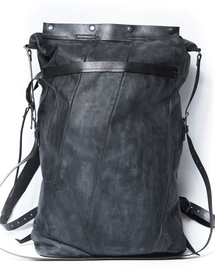 Leather travel rucksack 078Y - Dark blue – by independent designer ytn7, €685 at Vathir.com   Travel roomy backpack  - leather bag on a cotton lining, - one large compartment, one internal pocket with zipper (20x22cm), one small open pocket (10x15cm) - on the back of the backpack one pocket with metal zipper - backpack has 2 sizes, the top of the backpack is put inside the main...