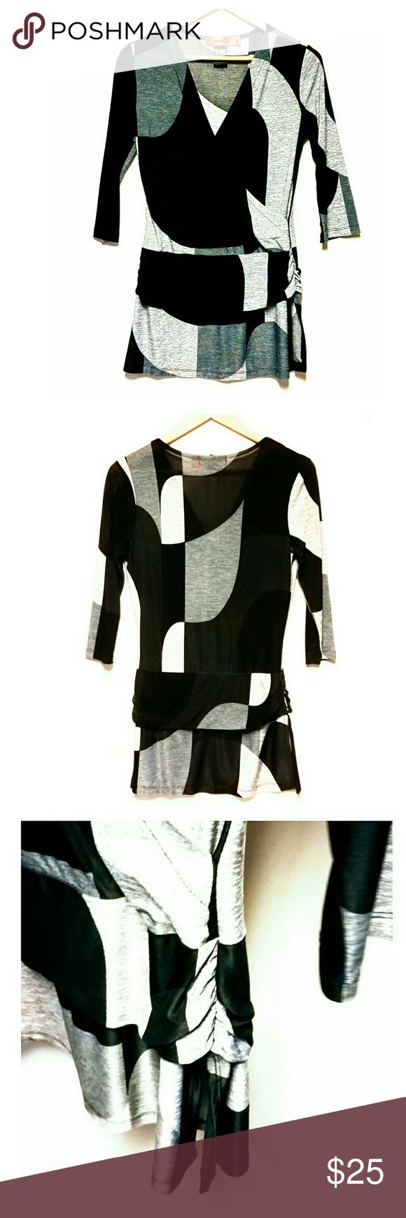 "Urban Mango Top Super cute black and gray top by Urban Mango. Size M. Excellent pre-owned condition. Approximate measurements laying flat: length 30"", bust 17.5"", waist waist 14.5"", sleeves 17"". Three-quarter length sleeves. Urban Mango Tops"