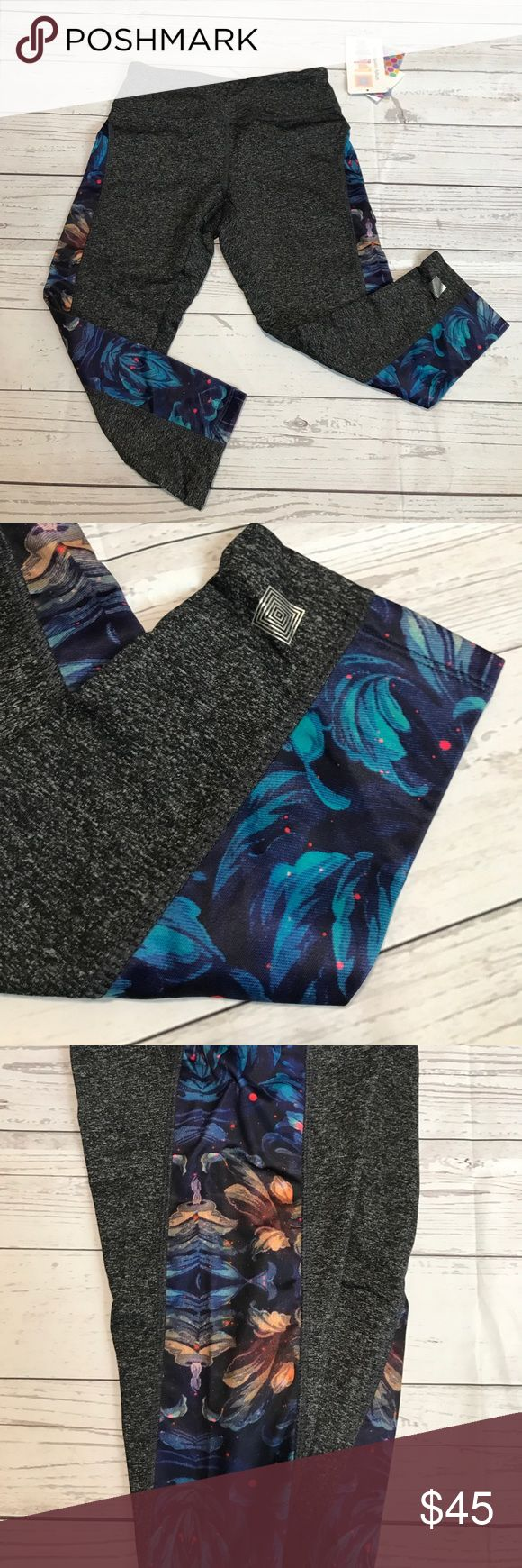 Xs Lularoe jade capris workout leggings Gray body with blue and orange floral design in the strip of the outer leg. NWT LuLaRoe Pants Capris