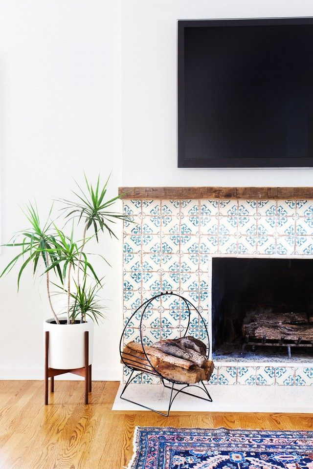 Fireplace with hand painted tiles in a California eclectic home.