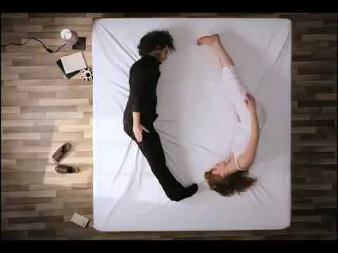 stop motion animation of people on a bed from birds eye view