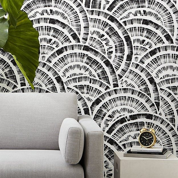 fanfare. Brushstrokes of unscripted semi-circles form a layered fan-like effect on this hand-printed paper by Hygge and West. Designed exclusively for CB2, repeating pattern forms a multi-dimensional illusion in black and white. We love it in the entry or as a statement wall.