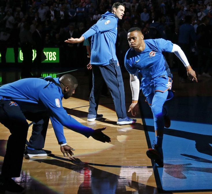 Oklahoma City's Russell Westbrook takes the floor, slapping hands with Nick Collison, top, and Raymond Felton, during introductions before an NBA basketball game between the Oklahoma City Thunder and the Boston Celtics at Chesapeake Energy Arena in Oklahoma City, Friday, Nov. 3, 2017. Photo by Nate Billings, The Oklahoman