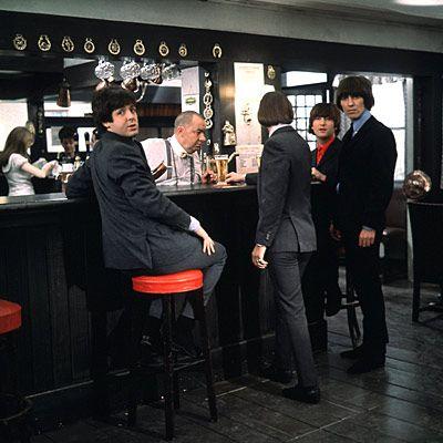 Paul McCartney, Richard Starkey, George  Harrison, and John Lennon (Four Beatles walk into a bar... (1965) the movie Help!)