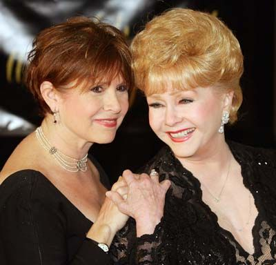 Actress Carrie Fisher, left, and her mother, actress Debbie Reynolds, arrive for Dame Elizabeth Taylor's 75th birthday party at the Ritz-Carlton, Lake Las Vegas on Feb. 27, 2007, in Henderson, Nev.