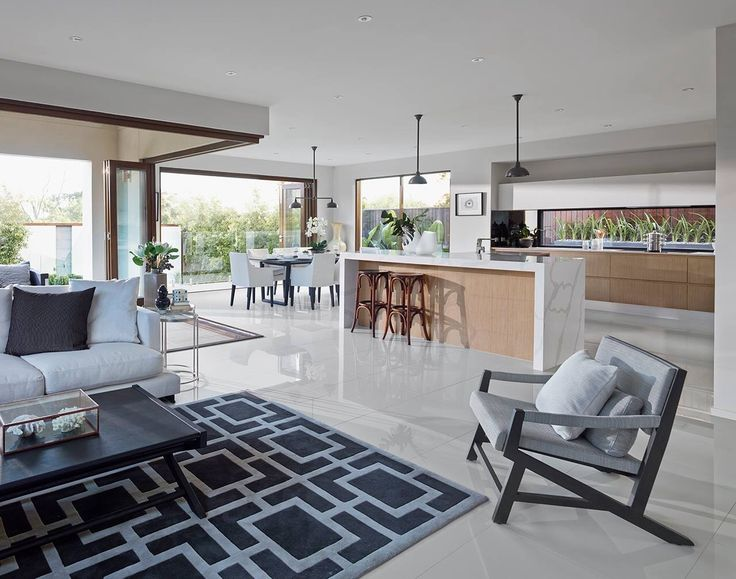 Metricon homes - these are the stacker doors, kitchen is ideal to our layout and concept with timber and marble. delete pendant lights over dining table and have 3 over island bench.