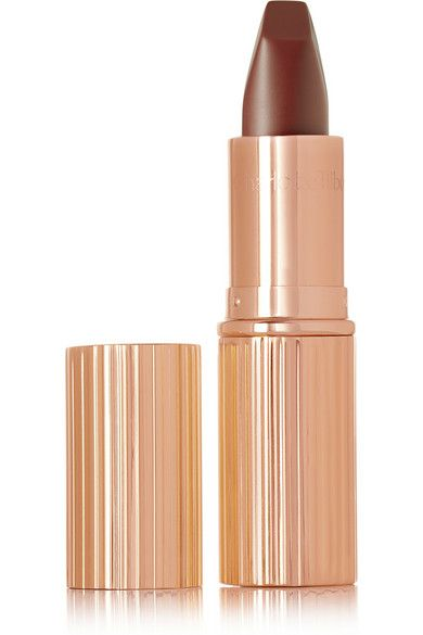 Charlotte Tilbury Matte Revolution Lipstick in Birkin Brown ($32): Packed full of 3D light-reflecting particles, this lip color will look amazing from every angle. A creamy, chocolatey hue like this one brings warmth to your makeup look, so rock it freely with your fave frosty white gown.