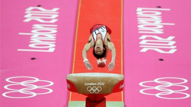 Kohei Uchimura of Japan competes on the vault in the Artistic Gymnastics men's Team final on Day 3 of the London 2012 Olympic Games at North Greenwich Arena.
