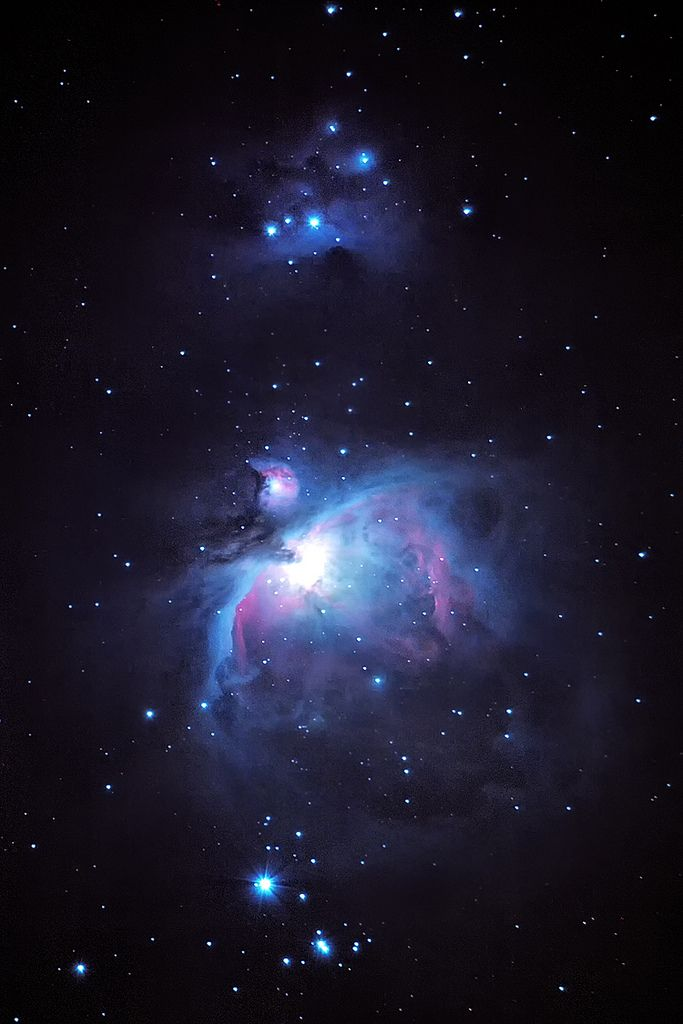 "The orion nebula region as captured from my backyard in Austin, Texas last Saturday night.  I had been waiting for that perfect moonless night, free of clouds, but it just wasn't happening.  The moon was 2/3 full and about 20 degrees away.  I couldn't run very long exposures or high iso, but still I think this is my best effort so far.  Still a work in progress, but getting there.  Imaged with a CLS_CCD filtered canon 7D and 100-400mm lens at 400mm riding piggy back on Meade 8"" LX200…"