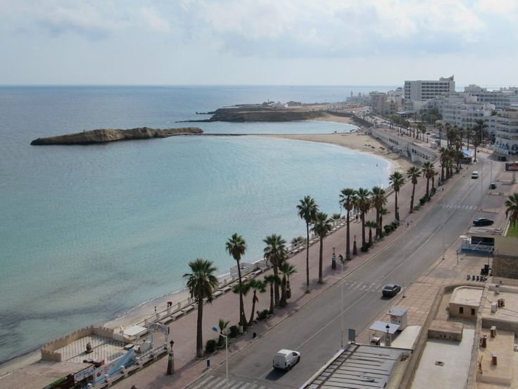 A beach stretches along the Mediterranean waterfront in downtown Monastir, Tunisia.