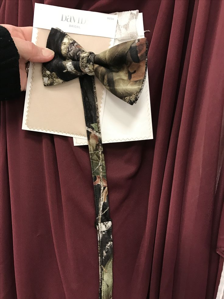 Wine, ivory, and champagne wedding colors with missy oak camo tie. A little camo added but keeping the elegance.