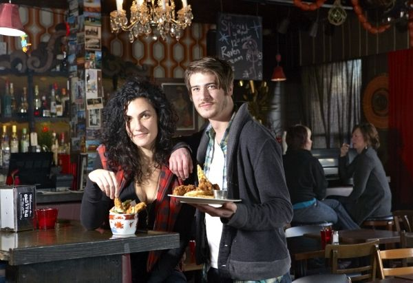 Co-owner Rachel Zottenberg and server Jason Wheeler dish up deep-fried pickles, chicken and waffles, and a whole lot of kitschy '70s nostalgia at the Rumpus Room on Main Street.