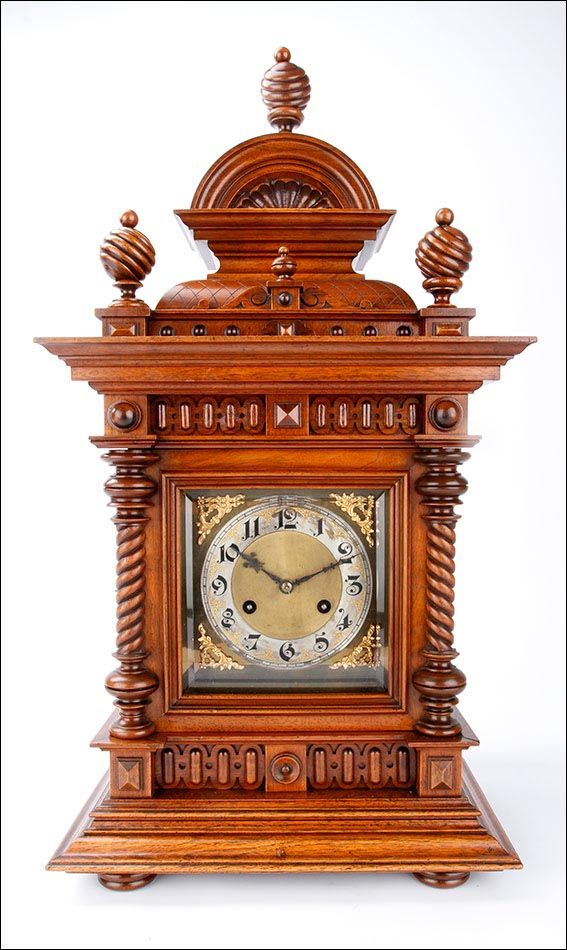 Desktop Antique Clock Junghans. Germany, 1900 --- Impressive desktop clock with carved wooden box, metal sphere with gold appliques and chiming hours and half. The clock was made ​​in Germany in the early twentieth century (circa 1900) More