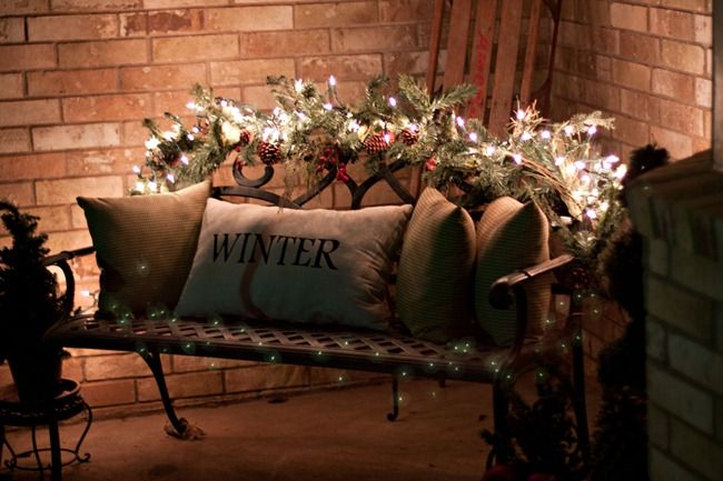 love the garland and lights on the bench. Can't wait to do this on our porch!!!