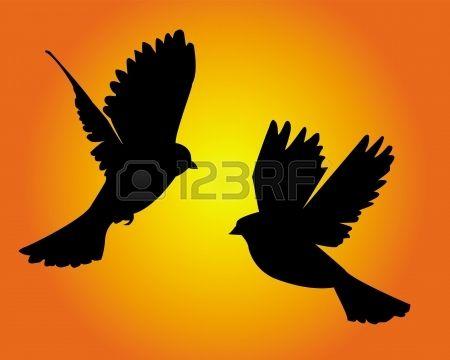 zwarte silhouetten van twee duiven op een gele achtergrond photo