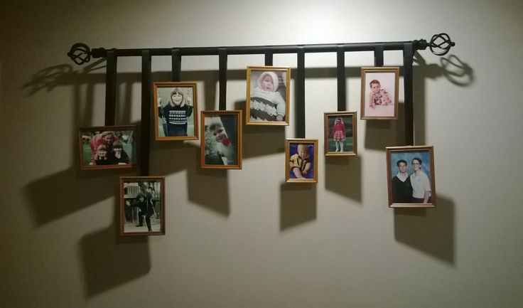 Hanging Family Photos From A Wrought Iron Curtain Rod With