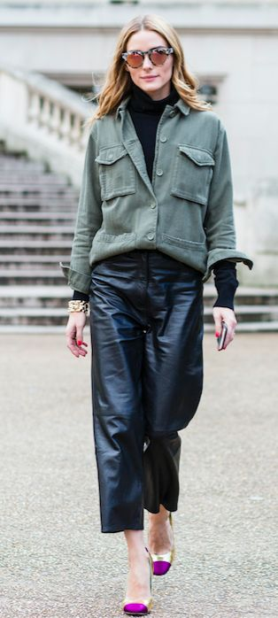 Olivia Palermo elevates a khaki shirt by layering it over a simple black rollneck. And let's not forget leather trousers and mirrored lenses - clashing textures to full effect.
