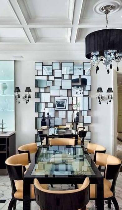 wonderfully graphic wall design/ decorative mirrors creates a stunning reflection