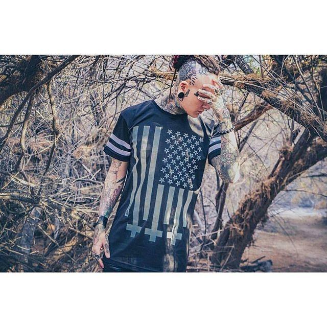 """Amerikunt"" Striped Mesh Tee Available at www.crmc-clothing.co.uk | WE SHIP WORLDWIDE Model - @ryan_wreckless Photography by @cdbennettphotography #darkwear #blasphemy #blackwear #americunt #starsandstripes #altfashion #alternative #fashionstatement  #fashionista  #starspangledbanner #menwithtattoos #meshtee #Pentagrams #styles #style #alternativeguy #alternativeboy #alternativegirl #alternativeteen #need #want #gimme #love #ryanwreckless #tattooedmen"