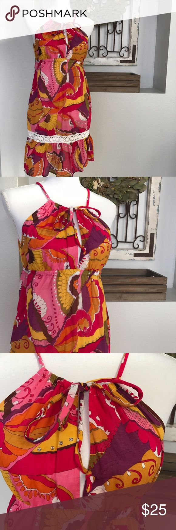 """Trina Turk Spring/ Summer Floral Dress Trina Turk Spring/ Summer Floral Dress. Size large. Armpit to armpit 16"""", total length of dress is 33"""" long. The last picture I held up to my window to show how sheer this dress is. Trina Turk Dresses Midi"""