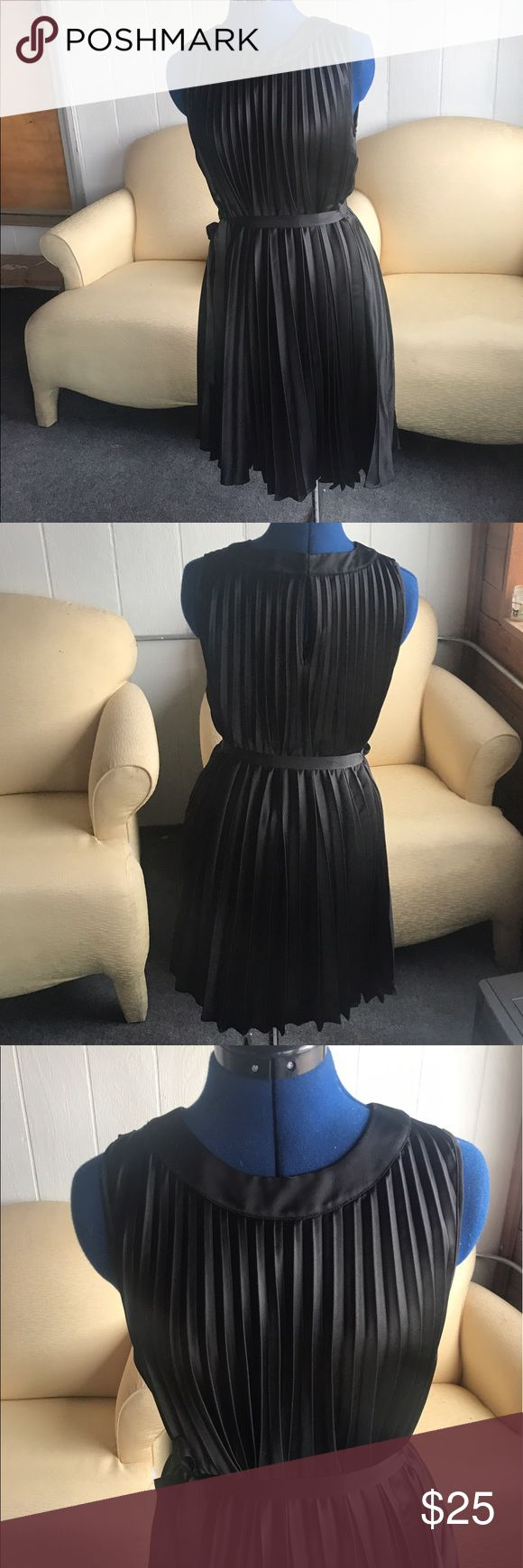 Black Satin pleated cocktail Dress GORG 😍😍😍😍 like new amazing, show stopper dress. Size 8 but would fit smaller or larger sizes because it ties at The waist. Length is to the knee on a 5'5 height. Dresses Midi