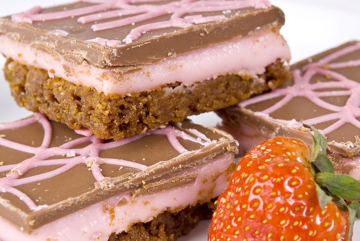 Strawberry fondant sandwiched on a chocolate biscuit base topped with Belgian milk chocolate coating and spun with pink coloured white chocolate. 15 squares per traybake.